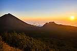 Flores sunset over fog bank, showing Mount Inerie and eroded volcanoes