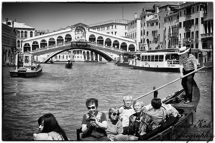 Japanese tourists in a gondola near the Rialto Bridge