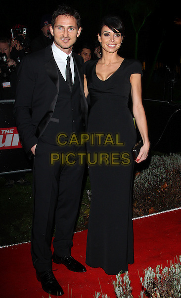 Frank Lampard and Christine Bleakley.The Sun Military Awards - 'The Millies' - at the Imperial War Museum, London, England..December 19th 2011.full length black suit dress couple .CAP/ROS.©Steve Ross/Capital Pictures