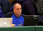 13 February 2011: Statistician Paul Stanfield works at his laptop during a game between the University of Vermont Catamounts and the Binghamton University Bearcats at Patrick Gymnasium in Burlington, Vermont. The Catamounts came from behind to defeat the Bearcats 60-51 in their America East matchup. The Cats took part in the National Pink Zone Breast Cancer Awareness Program by wearing special white jerseys with pink trim. The jerseys were auctioned off following the game with proceeds going to the Vermont Cancer Center. Mandatory Credit: Ed Wolfstein Photo