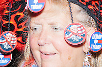 Audrey Blondin, a Connecticut delegate for Bernie Sanders, wears anti-Trump ornaments on her hat on the final day of the Democratic National Convention at the Wells Fargo Center in Philadelphia, Pennsylvania, on Thurs., July 28, 2016.