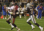 Tampa Bay Buccaneers wide receiver Tim Brown (81) gets away from Oakland Raiders defensive back Phillip Buchanon (31) on Sunday, September 26, 2004, in Oakland, California. The Raiders defeated the Buccaneers 30-20.