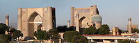 Panoramic view of Bibi-Khanym Mosque, 15th century,  Samarkand, Uzbekistan, pictured on July 19, 2010, at dawn. Named after the wife of Amir Timur, 14th century ruler, the mosque was constructed following his 1399 Indian campaign. It collapsed after an earthquake in 1897 and was restored in the late 20th century. Picture shows main entrance portal, (left), main building which was used as a huge Mihrab, (centre), one of the three domed buildings (right) and the 4 corner minarets. Samarkand, a city on the Silk Road, founded as Afrosiab in the 7th century BC, is a meeting point for the world's cultures. Its most important development was in the Timurid period, 14th to 15th centuries. Picture by Manuel Cohen.