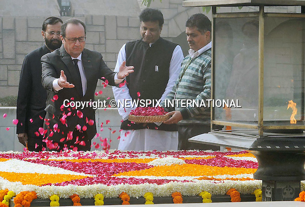 25.01.2016; Delhi, India: PRESIDENT HOLLANDE OF FRANCE<br /> pays a floral tributes at the Samadhi of Mahatma Gandhi, at Rajghat, in Delhi.<br /> The French President in the guest of honour for the Republic Day celebrations on the 26th of January 2016.<br /> Mandatory Credit Photos: &copy;NEWSPIX INTERNATIONAL<br /> <br /> PHOTO CREDIT MANDATORY!!: NEWSPIX INTERNATIONAL(Failure to credit will incur a surcharge of 100% of reproduction fees)<br /> <br /> IMMEDIATE CONFIRMATION OF USAGE REQUIRED:<br /> Newspix International, 31 Chinnery Hill, Bishop's Stortford, ENGLAND CM23 3PS<br /> Tel:+441279 324672  ; Fax: +441279656877<br /> &quot;All fees payable to &quot;Newspix International&quot;<br /> e-mail: info@newspixinternational.co.uk