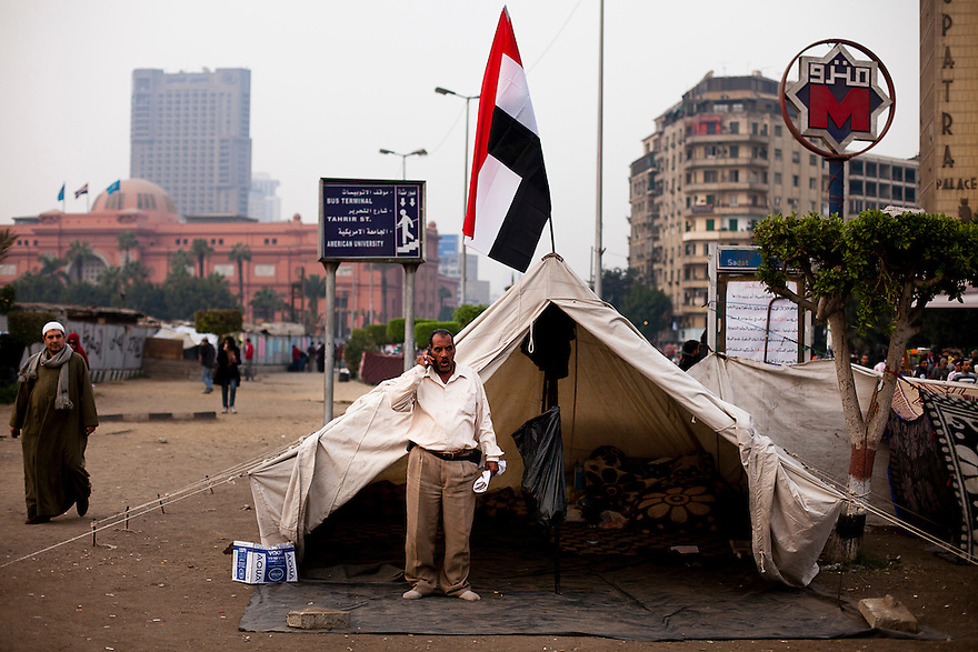 A man living in Cairo's Tahrir Square, a day before Egyptians will vote in the first round of parliamentary elections. Hundreds of people have taken over the square in preparation for a long struggle to push the army to hand over control of the government to a civilian hands.