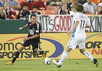 Carlos Verela #11 of D.C. United closes in on Bobby Convey #11 of the San Jose Earthquakes during an MLS match at RFK Stadium in Washington D.C. on October 9 2010. San Jose won 2-0.