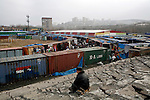 Photo by Heathcliff Omalley..Vladivostok, Russia 25 November 2007.A market in a disused stadium with stalls mainly owned by Chinese immigrants in the City of Vladivostok in Far Eastern Russia, which is home to Russia's Pacific Fleet and was a closed city until 1992.