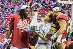 Alabama Crimson Tide head coach Nick Saban, center, with the Peach Bowl trophy, offensive MVP Bo Scarbrough, left, and defensive MVP Ryan Anderson celebrate defeating Washington 24-7 in the 2016 Peach Bowl at the Georgia Dome in Atlanta, Georgia on December 31, 2016. Photo by Mark Wallheiser/UPI