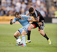 Chris Pontius (13) of D.C. United fights for the ball with Neven Markovic (25) of Sporting Kansas City during the game at Livestrong Sporting Park in Kansas City, Kansas.  D.C. United lost to Sporting Kansas City, 1-0.