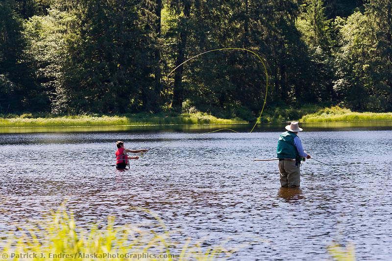 Grandpa and grandson flyfishing on Ward Lake in Ketchikan, Alaska.