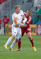 20 April 2013: Houston Dynamo midfielder Andrew Driver #20 and Toronto FC midfielder Ryan Richter #33 in action during the second half in an MLS game between the Houston Dynamo and Toronto FC at BMO Field in Toronto, Ontario Canada..The game ended in a 1-1 draw...