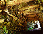 Carn Euny Fogou, Nr Penzance, Cornwall. England. Celtic Britain published by Orion. The prehistoric village settlement of Carn Euny is over 2,000 years old. There is evidence of an earlier occupation, but the site is primarily Iron Age. This underground cave in Cornish Fogou  original purpose is unknown, and was entered by a small narrow 'creep' passage.