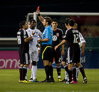 Jaime Moreno (99) of D.C. United is given a red card by referee Alex Prus during a game at RFK Stadium in Washington, DC.  San Jose defeated D.C. United, 2-0.