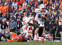 Nov 13, 2010; Charlottesville, VA, USA;  Maryland Terrapins quarterback Danny O'Brien (5) runs in for a touchdown during the 1st half of the game against the Virginia Cavaliers at Scott Stadium.  Mandatory Credit: Andrew Shurtleff