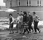 Bethel Park Senior High School:  View of students walking to the cafeteria - 1964.   The new Bethel Senior High School was dedicated on October 23, 1960, but the campus would not grow to its current size until seven years later. Phase II of the construction was completed in 1964 with the addition of another academic building and the industrial arts building. Phase III was completed in 1967 with the construction of the fourth academic building and a 6,300 seat football stadium and track, three tennis courts, seven basketball courts and a baseball field.