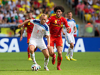 Denis Glushakov of Russia and Marouane Fellaini of Belgium