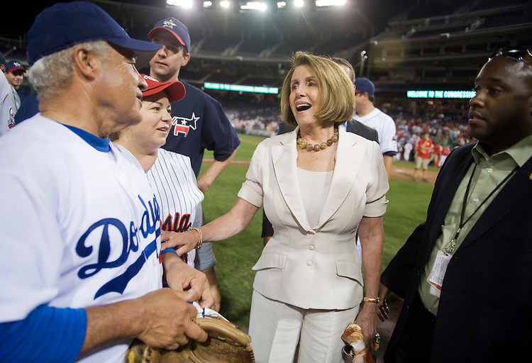 UNITED STATES - JULY 14:  House Minority Leader Nancy Pelosi, D-Calif., center, talks with Reps. Joe Baca, D-Calif., and Linda Sanchez, D-Calif., after the 50th Annual Congressional Baseball Game at Nationals Park.  The Democrats prevailed over the Republicans by the score of 8-2.  (Photo By Tom Williams/Roll Call)