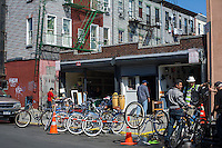 Bike shop in the Bushwick neighborhood of Brooklyn in New York on Saturday, April 27, 2013. The neighborhood is undergoing gentrification changing from a rough and tumble mix of Hispanic and industrial to a haven for hipsters, forcing many of the long-time residents out because of rising rents.  (© Frances M. Roberts)