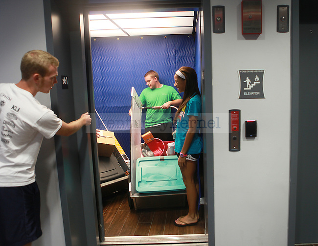 Students move in to south campus dorms in Lexington, Ky., on Friday, August 23, 2013. Photo by Emily Wuetcher | Staff