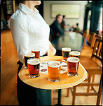 """a round of """"tasters"""" from the Bridgeport Ale House in the Hawthorne Shopping District in SouthEast Portland."""
