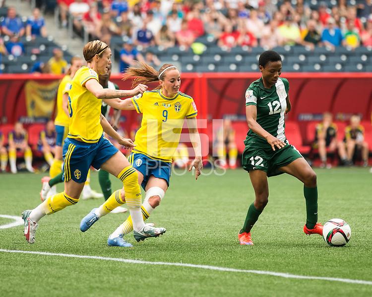 WINNIPEG, MANITOBA, CANADA - June 8, 2015: The Woman's World Cup Sweden vs Nigeria match at the Winnipeg Stadium . Final score, Sweden 3, Nigeria 3.