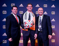 #16 overall pick A.J Cochran of the Houston Dynamo stands with head coach Dominic Kinnear (right) during the MLS SuperDraft at the Pennsylvania Convention Center in Philadelphia, PA, on January 16, 2014.