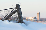 Farm Gate in Snow with Farm in Background