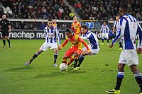 VOETBAL: ABE LENSTRA STADION: HEERENVEEN: 30-11-2013, SC Heerenveen - Go Ahead Eagles, uitslag 3-1, Jarchinio Antonia (#7 | GAE), Mitchell Dijks (#3 | SCH), ©foto Martin de Jong