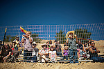 Three-year-old Sox Schacht, left, and his five-year-old brother, Flint, right watch the 51st annual International Camel Races in Virginia City, Nevada  September 12, 2010. .CREDIT: Max Whittaker for The Wall Street Journal.CAMEL