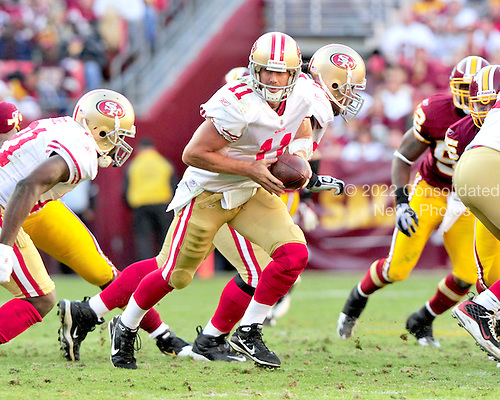 San Francisco 49ers quarterback Alex Smith (11) prepares to hand-off to running back Frank Gore (21) in the fourth quarter against the Washington Redskins at FedEx Field in Landover, Maryland on Sunday, November 6, 2011.  The 49ers won the game 19 - 11..Credit: Ron Sachs / CNP