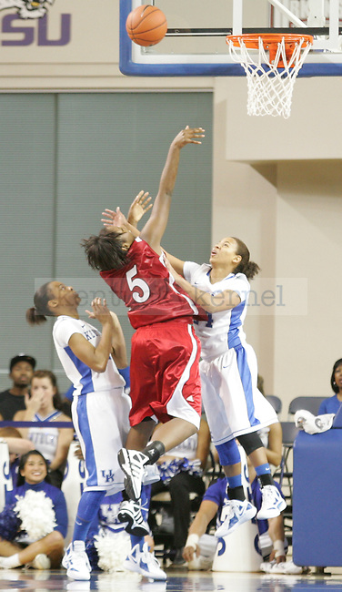 UK point guard Amber Smith attempts to block a shot during the first half of UK's Women's basketball game against Jacksonville State in Lexington, Ky. on 11/15/11. Photo by Quianna Lige | Staff