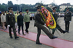 Goose stepping guards carry a donated floral weath to Ho Chi Ming's marble tomb on Dien Bien Phu Street in Hanoi, North Vietnam.  (Jim Bryant Photo).....