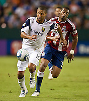 CARSON, CA – August 27, 2011: Real Salt Lake forward Alvaro Saborio (15) moves the ball up the pitch in front of Chivas USA defender David Junior Lopes (77) during the match between Chivas USA and Real Salt Lake at the Home Depot Center in Carson, California. Final score Chivas USA 0, Real Salt Lake 1.