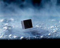 SUPERCONDUCTOR: MEISSNER EFFECT<br /> Diamagnetic State Created With Liquid Nitrogen<br /> Liquid nitrogen brings ceramic disc formulated from the oxides of Yttrium, Barium, and Copper (YBa2Cu3O7) to its superconducting diamagnetic state preventing any magnetic field from entering it, which causes the small magnet to levitate.