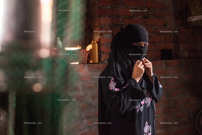 Sultana, aged 16, prepares to go out in her home in Varanasi, Uttar Pradesh, India on 23 November 2013. Sultana was enticed by a trafficker on the pretext of marriage and was raped repeatedly as he filmed her, using the film to blackmail her as he sold her to another trafficker for INR50000 (USD800). Guria has since put almost all of her traffickers into jail, and has provided her with a grant for livelihood support, which she used to start her saree embellishment business.