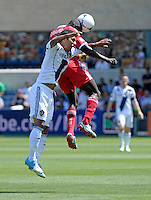 LA Galaxy defender A.J. DeLaGarza (20) gets tangled up with Chicago forward Dominic Oduro (8) as they battle for a header.  The LA Galaxy defeated the Chicago Fire 2-0 at Toyota Park in Bridgeview, IL on July 8, 2012.