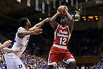 30 October 2015: Florida Southern's Dominique Williams (12) shoots over Duke's Matt Jones (13). The Duke University Blue Devils hosted the Florida Southern College Moccasins at Cameron Indoor Stadium in Durham, North Carolina in a 2015-16 NCAA Men's Basketball Exhibition game. Duke won the game 112-68.