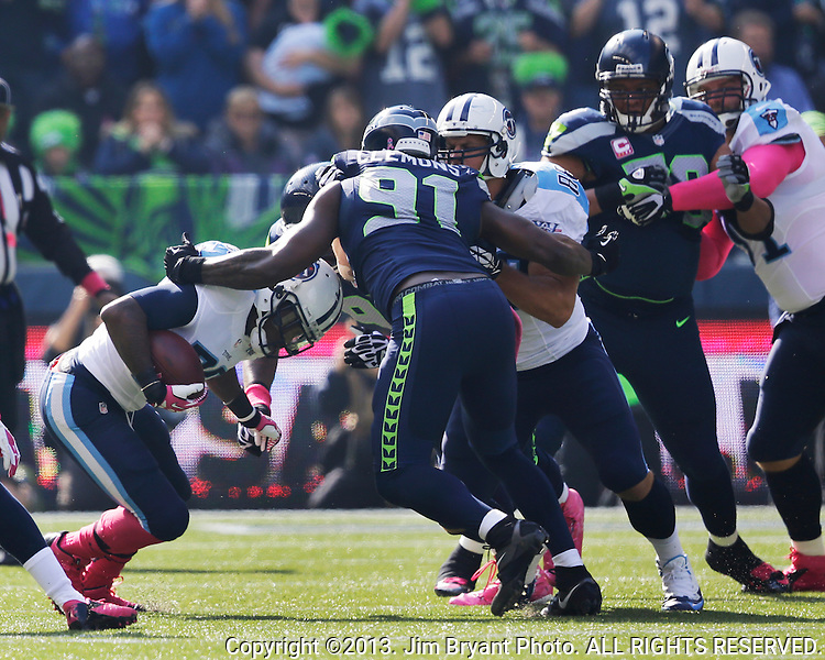 Seattle Seahawks defensive end Chris Clemons t (91) stops Tennessee Titians running back Chris Johnson for a loss at CenturyLink Field in Seattle, Washington on October 13, 2013. The Seattle Seahawks beat the Titians  20-13.   ©2013. Jim Bryant Photo. All Rights Reserved.