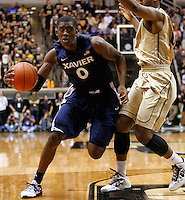 WEST LAFAYETTE, IN - DECEMBER 01: Semaj Christon #0 of the Xavier Musketeers dribbles to the hoop against Terone Johnson #0 of the Purdue Boilermakers at Mackey Arena on December 1, 2012 in West Lafayette, Indiana. Xavier defeated Purdue 63-57. (Photo by Michael Hickey/Getty Images) *** Local Caption *** Semaj Christon; Terone Johnson