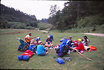 Backpackers resting in Divide Meadow on Bear Valley Trail