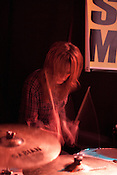 Sara Romweber keeps the beat during a Dex Romweber Duo performance at Slim's during the final day of the Hopscotch Music Festival in Raleigh, N.C., Sat., Sept. 11, 2010.