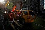 People dressed as Santa Claus take a taxi to attend the Santacon Annual Festival around Manhattan in New York, United States. 14/12/2012. Photo by ZAMEK