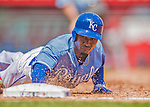 25 August 2013: Kansas City Royals outfielder Jarrod Dyson dives safely back to first during a game against the Washington Nationals at Kauffman Stadium in Kansas City, MO. The Royals defeated the Nationals 6-4, to take the final game of their 3-game inter-league series. Mandatory Credit: Ed Wolfstein Photo *** RAW (NEF) Image File Available ***