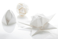 New York, NY, USA - November 4, 2011: Three origami creations folded by Esme Cribb. Left Spring Bud designed by Jeannine Mosely. Center an Ishibashi ball designed by Japanese Origami artist Minako Ishibashi. Right Puff Stardesigned by Philip Chapman-Bell.