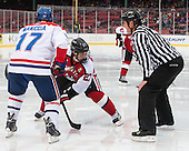 Chris Maniccia (UML - 17), Dalen Hedges (NU - 27), Chris Aughe - The Northeastern University Huskies defeated the University of Massachusetts Lowell River Hawks 4-1 (EN) on Saturday, January 11, 2014, at Fenway Park in Boston, Massachusetts.