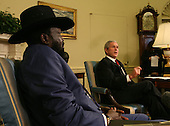 Washington, DC - January 5, 2009 -- United States President George W. Bush makes statement to the media on the situation in Gaza as he meets with Salva Kiir, First Vice President of the Government of National Unity of Sudan and President of the Government of Southern Sudan in the Oval Office on Monday, January 5, 2009. .Credit: Dennis Brack - Pool via CNP