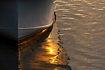 Reflection of the sunset on the hull of a fishing boat on Shem Creek in Mt Pleasant South Carolina