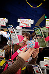 (Eng) Yokohama, March 6 2010 - At the Tokyo Girls Collection, models and TV stars are parading for fast-fashion brands in front of 20 000 teenagers. In boot selling mobil phones accessories, most of the items are sold out.<br /> <br /> (Fr)Yokohama, 6 mars 2010 - A la Tokyo Girl Collection, des mannequins et stars de la television defilent pour des marques grand-public devant 20 000 adolescentes. Sur un stand d'accessoires pour telephone portable, la plupart des modeles sont en rupture de stock.