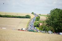 peloton moving through the french landscape<br /> <br /> 2014 Tour de France<br /> stage 4: Le Touquet-Paris-Plage/Lille M&eacute;tropole (163km)