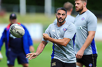 Dan Bowden of Bath Rugby passes the ball during the pre-match warm-up. Pre-season friendly match, between the Scarlets and Bath Rugby on August 20, 2016 at Eirias Park in Colwyn Bay, Wales. Photo by: Patrick Khachfe / Onside Images